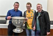 20 September 2014; Dara Ó Cinnéide is the latest to feature on the Bord Gáis Energy Legends Tour Series 2014 when he gave a unique tour of the Croke Park stadium and facilities this week. Pictured is Dara Ó Cinnéide and the Sam Maguire Cup with Adrian and Cyril Dunnion from Dublin. Croke Park, Dublin. Picture credit: Paul Mohan / SPORTSFILE