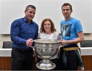 20 September 2014; Dara Ó Cinnéide is the latest to feature on the Bord Gáis Energy Legends Tour Series 2014 when he gave a unique tour of the Croke Park stadium and facilities this week. Pictured is Dara Ó Cinnéide and the Sam Maguire Cup with Norma Myers and Denis Naughton from Killarney, Co. Kerry . Croke Park, Dublin. Picture credit: Paul Mohan / SPORTSFILE