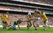 21 September 2014; Kerry's Paul Geaney, supported by team-mate Kieran Donaghy, left, gets his shot away despite the challenge of Donegal's Neil Gallagher, left, and Karl lacey, right. GAA Football All Ireland Senior Championship Final, Kerry v Donegal. Croke Park, Dublin. Picture credit: Pat Murphy / SPORTSFILE