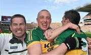 21 September 2014; Kieran Donaghy, Kerry, celebrates his side's victory with team-mate David Moran and water carrier Eddie Walsh. GAA Football All Ireland Senior Championship Final, Kerry v Donegal. Croke Park, Dublin. Picture credit: Stephen McCarthy / SPORTSFILE