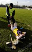 4 March 2007; Wexford physio Fran Fitzhenry assists Paul Roche after the game. Allianz National Hurling League, Division 1A Round 2, Clare v Wexford, Cusack Park, Ennis, Co. Clare. Picture credit: Ray McManus / SPORTSFILE