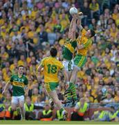 21 September 2014; David Moran, Kerry, contests a kick out with Martin McElhinney, Donegal. GAA Football All Ireland Senior Championship Final, Kerry v Donegal. Croke Park, Dublin. Picture credit: Brendan Moran / SPORTSFILE