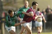 7 March 2004; Joe Bergin of Galway in action against Timmy Carroll of Limerick during the Allianz Football League Division 1B Round 4 match between Galway and Limerick at Duggan Park in Ballinasloe, Galway. Photo by Pat Murphy/Sportsfile