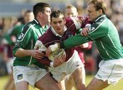 7 March 2004; Damien Burke of Galway in action against Conor Mullane, left, and Damien Reidy of Limerick during the Allianz Football League Division 1B Round 4 match between Galway and Limerick at Duggan Park in Ballinasloe, Galway. Photo by Pat Murphy/Sportsfile