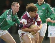 7 March 2004; Matthew Clancy of Galway on his way to scoring his side's first goal despite the challenge of Tommy Stack of Limerick during the Allianz Football League Division 1B Round 4 match between Galway and Limerick at Duggan Park in Ballinasloe, Galway. Photo by Pat Murphy/Sportsfile