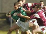 7 March 2004; Tommy Stack of Limerick is tackled by Tommie Joyce of Galway during the Allianz Football League Division 1B Round 4 match between Galway and Limerick at Duggan Park in Ballinasloe, Galway. Photo by Pat Murphy/Sportsfile