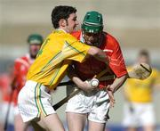 17 March 2004; James Bowles, Newtownshandrum, is tackled by Frankie McMullan, Dunloy. AIB All-Ireland Club Hurling Final, Newtownshandrum v Dunloy, Croke Park, Dublin, Photo by Brendan Moran/Sportsfile