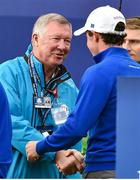 28 September 2014; Sir Alex Ferguson shakes hands with Rory McIlroy, Team Europe, before the start of his Singles Match against Rickie Fowler, Team USA. The 2014 Ryder Cup, Final Day. Gleneagles, Scotland. Picture credit: Matt Browne / SPORTSFILE