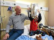 27 September 2014; Kilkenny manager Brian Cody watches Jonah Fanning, age 7, from Wicklow, lift the Liam MacCarthy Cup. Victorious Kilkenny Champions visit Our Lady's Children Hospital. Our Lady's Children Hospital, Crumlin, Co Dublin. Picture credit: Pat Murphy / SPORTSFILE