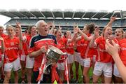 28 September 2014; Cork manager Eamon Ryan and the team celebrate with the Brendan Martin Cup after the game. TG4 All-Ireland Ladies Football Senior Championship Final, Cork v Dublin. Croke Park, Dublin. Picture credit: Brendan Moran / SPORTSFILE