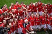 28 September 2014; Members of the Cork squad and manager Eamonn Ryan celebrate after the presentation. TG4 All-Ireland Ladies Football Senior Championship Final, Cork v Dublin. Croke Park, Dublin. Picture credit: Ray McManus / SPORTSFILE
