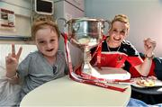 29 September 2014; Cork captain Briege Corkery with eight year old Harry Cooke, from Glasnevin, Co. Dublin, and the Brendan Martin Cup during a visit to Temple Street Childrens Hospital, Dublin. Picture credit: Paul Mohan / SPORTSFILE