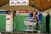 1 October 2014; Ian McLoughlin, Neptune, helps make the prize draw during the launch of the Basketball Ireland 2014/2015 Season. As winter approaches, Ireland's most popular indoor sport officially launched its new season today. Basketball clubs from around the country gathered at the National Basketball Arena in Tallaght for the launch of the national league season for 2014/2015. All the action gets underway this Saturday as 32 teams across 4 divisions fight it out to be the best basketballers in the country. Women's Premier League and Cup Champions Team Montenotte get their account underway against Singleton Supervalu Brunell in a Cork derby while defending Men's Champions Killester are away to DCU Saints. The draw for the National Cups also took place today. National Basketball Arena, Tallaght, Dublin. Picture credit: Brendan Moran / SPORTSFILE