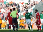 24 March 2007; Referee,Terje Hauge shows a yellow card to Republic of Ireland captain Robbie Keane. 2008 European Championship Qualifier, Republic of Ireland v Wales, Croke Park, Dublin. Picture credit: David Maher / SPORTSFILE