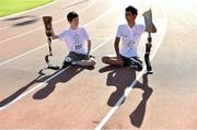 4 October 2014; 13 year old Josh Dunne, left, from Tallaght, Co. Dublin, and 16 year old Pawan Sitthisung, from Navan, Co. Meath, pictured at the first ever running blades workshop held in Ireland hosted by Paralympics Ireland in partnership with sponsors Mondelez, and blade manufacturer Ottobock. The unique event saw eight individuals who had been prefitted for the technology given the opportunity to experience and showcase the blades with almost fifty additional prosthesis users and amputees taking part in activity session to promote Paralympic sport. Morton Stadium, Santry, Dublin. Picture credit: Paul Mohan / SPORTSFILE