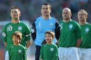 24 March 2007; Republic of Ireland players, from left, captain Robbie Keane, Shay Given, Lee Carsley, and Damien Duff, stand with mascots for the National Anthem. 2008 European Championship Qualifier, Republic of Ireland v Wales, Croke Park, Dublin. Picture credit: Brian Lawless / SPORTSFILE