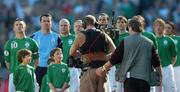 24 March 2007; The Republic of Ireland team, from left, captain Robbie Keane, Shay Given, Lee Carsley, Damien Duff, John O'Shea, Kevin Kilbane, Richard Dunne, hidden, Paul McShane, and Jonathan Douglas, stand with mascots for the National Anthem, as they are watched by a TV cameraman. 2008 European Championship Qualifier, Republic of Ireland v Wales, Croke Park, Dublin. Picture credit: Brian Lawless / SPORTSFILE