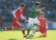 24 March 2007; Jonathan Douglas, Republic of Ireland, in action against Carl Robinson, left, and Simon Davies, Wales. 2008 European Championship Qualifier, Republic of Ireland v Wales, Croke Park, Dublin. Picture credit: Brian Lawless / SPORTSFILE
