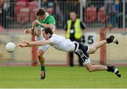 28 September 2014; Mark Donnelly, Carrickmore Naomh Colmcille,  has his shot blocked down by Justin McMahon, Omagh St. Enda's. Tyrone County Senior Football Championship Final, Carrickmore Naomh Colmcille v Omagh St. Enda's, Healy Park, Omagh, Co. Tyrone. Picture credit: Oliver McVeigh / SPORTSFILE