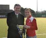 25 March 2007; Chief Executive of ESB Padraig McManus presents the cup to Pegasus captain Arlene Boyles. ESB Irish Women's Hockey Senior Cup Final, Pembroke Wanderers v Pegasus, Belfield, Dublin. Picture credit: Ray Lohan / SPORTSFILE  *** Local Caption ***