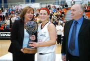 25 March 2007; DCU Mercy captain Sarah Hughes, is presented with the Women's Superleague trophy by Debbie Massey, Chief Executive, Basketball Ireland. Women's Superleague Final, UL Aughinish v DCU Mercy, UL Arena, Co. Limerick. Picture credit: Brendan Moran / SPORTSFILE