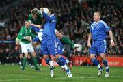 28 March 2007; Kevin Doyle, Republic of Ireland, shoots to score his side's first goal despite the attentons of Slovakia's Martin Skrtel. 2008 European Championship Qualifier, Republic of Ireland v Slovakia, Croke Park, Dublin. Picture credit: Brian Lawless / SPORTSFILE