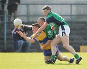 1 April 2007; Gordon Kelly, Clare, in action against Shaun Campbell and Declan Meehan, London. Allianz National Football League, Division 2A Round 5, Clare v London, Cusack Park, Ennis, Co. Clare. Picture credit: Kieran Clancy / SPORTSFILE