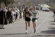 1 April 2007; Clonliffe Harriers A.C's Killian Lonergan, left, who took victory in the Mens Senior Relay race, leads Raheny Shamrock A.C's Mark Kirwan. AAI National Road Relay Championships, Raheny, Dublin. Picture credit: Tomás Greally / SPORTSFILE
