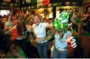 5 June 2002; Republic of Ireland fan Karen Reilly, centre, celebrates with patrons after Robbie Keane's late equaliser against Germany in the FIFA World Cup Finals. The Submarine Bar, Dublin. Picture credit: Brendan Moran / SPORTSFILE