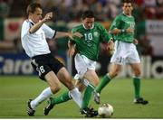 5 June 2002; Robbie Keane, Republic of Ireland, is tackled by Dietmar Hamann, Germany. FIFA World Cup Finals, Group E, Republic of Ireland v Germany, Ibaraki Stadium, Ibaraki, Japan. Picture credit: David Maher / SPORTSFILE