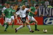 5 June 2002; Robbie Keane, Republic of Ireland, is tackled by Carsten Ramelow, Germany. FIFA World Cup Finals, Group E, Republic of Ireland v Germany, Ibaraki Stadium, Ibaraki, Japan. Picture credit: David Maher / SPORTSFILE
