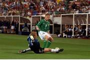 5 June 2002; Damien Duff, Republic of Ireland, is tackled by Germany goalkeeper Oliver Kahn. FIFA World Cup Finals, Group E, Republic of Ireland v Germany, Ibaraki Stadium, Ibaraki, Japan. Picture credit: David Maher / SPORTSFILE