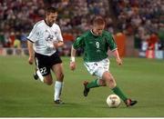5 June 2002; Damien Duff, Republic of Ireland, races clear of Torsten Frings, Germany. FIFA World Cup Finals, Group E, Republic of Ireland v Germany, Ibaraki Stadium, Ibaraki, Japan. Picture credit: David Maher / SPORTSFILE