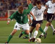 5 June 2002; Damien Duff, Republic of Ireland, is tackled by Torsten Frings, Germany. FIFA World Cup Finals, Group E, Republic of Ireland v Germany, Ibaraki Stadium, Ibaraki, Japan. Picture credit: David Maher / SPORTSFILE