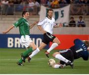5 June 2002; Robbie Keane, Republic of Ireland, has his shot saved by Germany goalkeeper Oliver Khan. FIFA World Cup Finals, Group E, Republic of Ireland v Germany, Ibaraki Stadium, Ibaraki, Japan. Picture credit: David Maher / SPORTSFILE