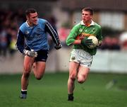 28 November 1999; Tomás Ó Sé of Kerry in action against Ciaran Whelan of Dublin during the Church & General National Football League match between Dublin and Kerry at Parnell Park in Dublin. Photo by Aoife Rice/Sportsfile