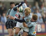 14 April 2007; Eoghan Hickey, Garryowen, is tackled by Gavin McLoughlin, left, and Paul Marshall, Belfast Harlequins. AIB Senior Cup Final, Garryowen v Belfast Harlequins, Dubarry Park, Athlone, Co. Westmeath. Picture credit; Matt Browne / SPORTSFILE