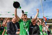 19 October 2014; Sarsfields captain Cian McConnell lifts the cup after the game. Kildare County Minor A Football Championship Final, Athy v Sarsfields. St Conleth's Park, Newbridge, Co. Kildare. Picture credit: Piaras O Midheach / SPORTSFILE