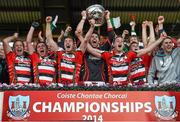 19 October 2014; Ballincollig captain David Lordan lifts the Andy Scannell Cup surrounded by team-mates. Cork County Senior Football Championship Final, Ballincollig v Carbery Rangers, Pairc Ui Chaoimh, Cork. Picture credit: Paul Mohan / SPORTSFILE