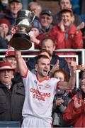 19 October 2014; Ballintubber captain Jason Gibbons, celebrates at the end of the game lifting the MoClair Cup. Mayo County Senior Football Championship Final, Castlebar Mitchels v Ballintubber, MacHale Park, Castlebar, Co. Mayo. Picture credit: David Maher / SPORTSFILE