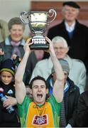 19 October 2014;  Michael Farragher, Corofin, lifts the Frank Fox cup. Galway County Senior Football Championship Final, Corofin v St Michael's, Tuam Stadium, Tuam, Co. Galway. Picture credit: Ray Ryan / SPORTSFILE