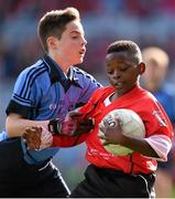 23 October 2014; Belguy Manzambi, St. Patrick's SNS, Corduff, in action against Conor Moriarty, St. Mary's BNS, Booterstown, during the Sciath Clanna Gael Final. Allianz Cumann na mBunscol Finals, Croke Park, Dublin. Picture credit: Pat Murphy / SPORTSFILE