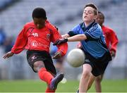 23 October 2014; Warith Omotoso, St. Patrick's SNS, Corduff, in action against Conor Moriarty, St. Mary's BNS, Booterstown, during the Sciath Clanna Gael Final. Allianz Cumann na mBunscol Finals, Croke Park, Dublin. Picture credit: Pat Murphy / SPORTSFILE