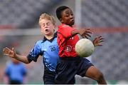 23 October 2014; David Loye, St. Patrick's SNS, Corduff, in action against Hugo McLaughlin, St. Mary's BNS, Booterstown, during the Sciath Clanna Gael Final. Allianz Cumann na mBunscol Finals, Croke Park, Dublin. Picture credit: Pat Murphy / SPORTSFILE