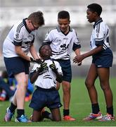 23 October 2014; Iminiu Tsalabiendze, St. Martin De Porres, Aylesbury, celebrates at the final whistle surrounded by team-mates, from left, Josh Hanley, Junior Ozhianvuna and Japhet Mbuenemo after winning the Corn Matt Griffin final. Allianz Cumann na mBunscol Finals, Croke Park, Dublin. Picture credit: Pat Murphy / SPORTSFILE