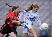 23 October 2014; Lauren Kearney, Bishop Galvin NS, Templeogue, in action against Rebecca Keane, St Colmcille's SNS, Knocklyon, left, during the Austin Finn Shield final. Allianz Cumann na mBunscol Finals, Croke Park, Dublin. Picture credit: Pat Murphy / SPORTSFILE