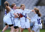 23 October 2014; Bishop Galvin NS, Templeogue, players, from left, Roisin Connolly, Una Nerney, Lauren Kearney and Caoimhe McKeown celebrate at the final whistle after winning the Austin Finn Shield final. Allianz Cumann na mBunscol Finals, Croke Park, Dublin. Picture credit: Pat Murphy / SPORTSFILE