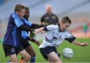 23 October 2014; Fionn Murray, St. Martin De Porres, Aylesbury, in action against Kyle Berney, left, and Kenny Ogundipe, Scoil Aine, Fettercairn, right, during the Corn Matt Griffin final. Allianz Cumann na mBunscol Finals, Croke Park, Dublin. Picture credit: Marcus Roche / SPORTSFILE