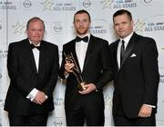24 October 2014; Mayo footballer Keith Higgins is presented with his 2014 GAA GPA All-Star award by Uachtarán Chumann Lúthchleas Gael Liam Ó Néill and Dessie Farrell, Chief Executive of the Gaelic Players Association. GAA GPA All-Star Awards 2014 Sponsored by Opel. Convention Centre, Dublin. Picture credit: Brendan Moran / SPORTSFILE