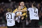 24 October 2014; Dundalk's Stephen O'Donnell, centre, celebrates scoring his side's first goal with team-mates Darren Meenan, left, and Andy Boyle, and a supporter. SSE Airtricity League Premier Division, Dundalk v Cork City, Oriel Park, Dundalk, Co. Louth. Picture credit: Ramsey Cardy / SPORTSFILE